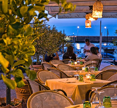 Restaurant with tables by the sea Capri